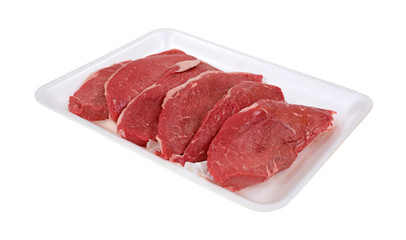 Small steaks on white meat tray