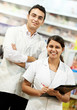 Two Pharmacy chemist in drugstore