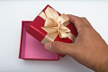 red gift box with hand