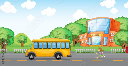 girl running behind school bus