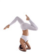 strong yoga woman in white stand on head asana