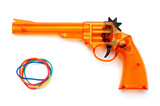 Toy plastic gun and elastic band , on a white background