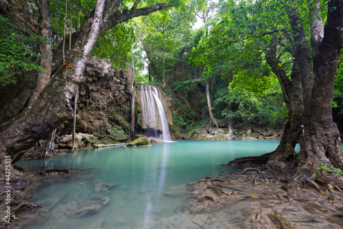 Vibrant Erawan Waterfall with Flowing Water into The Blue Lake