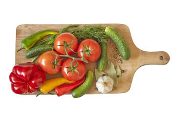 Vegetables and spices isolated on cutting board