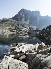 Dam in the alpine lake