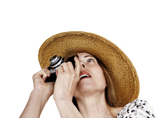 woman with straw hat and old analog camera