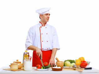 Young cook preparing food