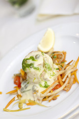 white fish fillet with butter sauce and vegetable