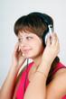 teenage girl listening to music on headphones