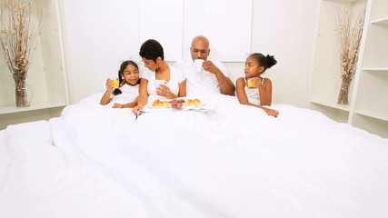 African American Parents Children Breakfast Bed