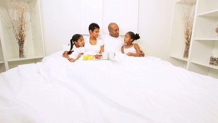 Ethnic Family Enjoying Breakfast Bedroom