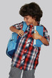 A beautiful schoolboy with blue bag, isolated on grey background