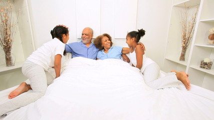 African American Grandparents Talking Grandchildren Bed