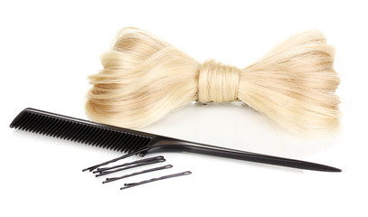 Shiny blond hair-pin and comb isolated on white