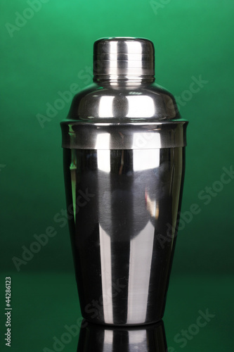 Cocktail shaker on green background