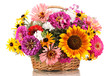 Beautiful bouquet of bright flowers in basket isolated on white