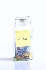 Glass jar with coins for crisis.