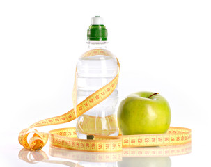 bottle with aqua, apple and measure