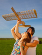 Girl and guy and model of airplane
