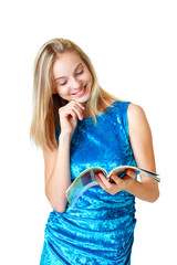 beautiful happy blond teenage girl looking on journal