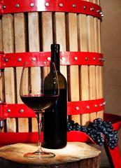 Wine making - glass of wine and wine press
