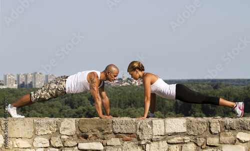 Pushups on a stone wall