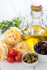 Mediterranean products. Pasta, tomatoes, capers and olives oil