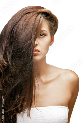 portrait of brunette woman with hair on the face