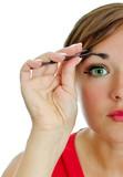 Attractive woman plucking her eyebrows with tweezers. poster