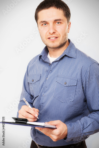 Casual businessman holding a clipboard