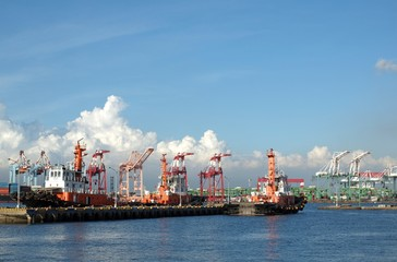Three Tugboats in a Container Port