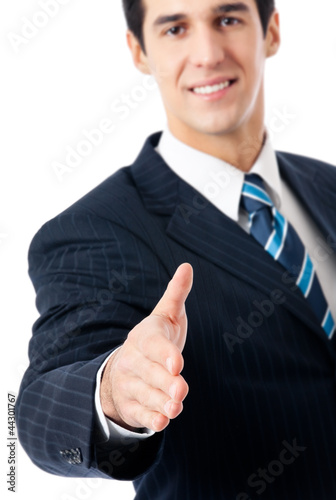 Businessman giving hand for handshake, isolated