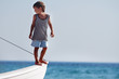 young happy boy on board of sea yacht