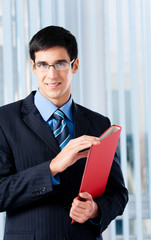 Young businessman with red folder