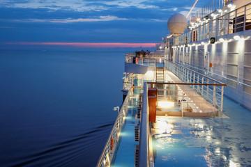 Deck of multidecked ship in evening light.
