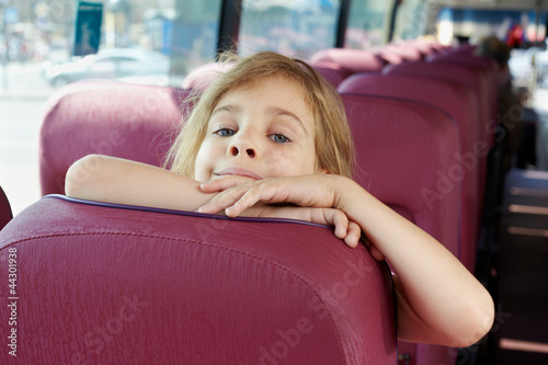 Closeup portrait of girl on bus seat