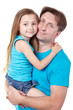 Man in blue t-shirt holds daughter on hands, they snuggle cheeks