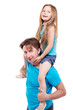 Smiling girl sits on father shoulders