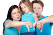 Family of three in blue shirts with disagreeable faces