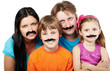 Family of four with glued articial mustaches.