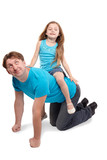 Father and little daughter in blue t-shirts play horse-ride