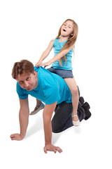 Father and little daughter play horse-ride