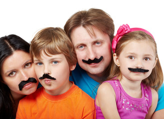 Family of four with glued artificial mustaches