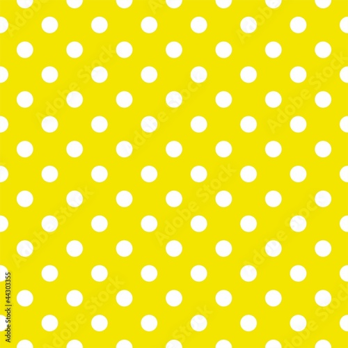 Polka dots on yellow background seamless vector pattern © ingalinder