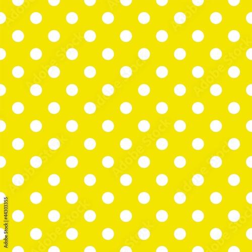 Polka dots on yellow background seamless vector pattern © ingalinder