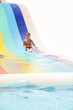 young smiling child having fun on aquapark partly isolated over