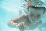 underwater portrait of young child