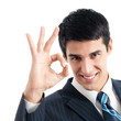Businessman with okay gesture, isolated