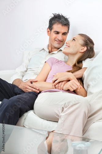 Relaxed Couple Sitting On Sofa