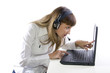 Woman with headphone working on laptop